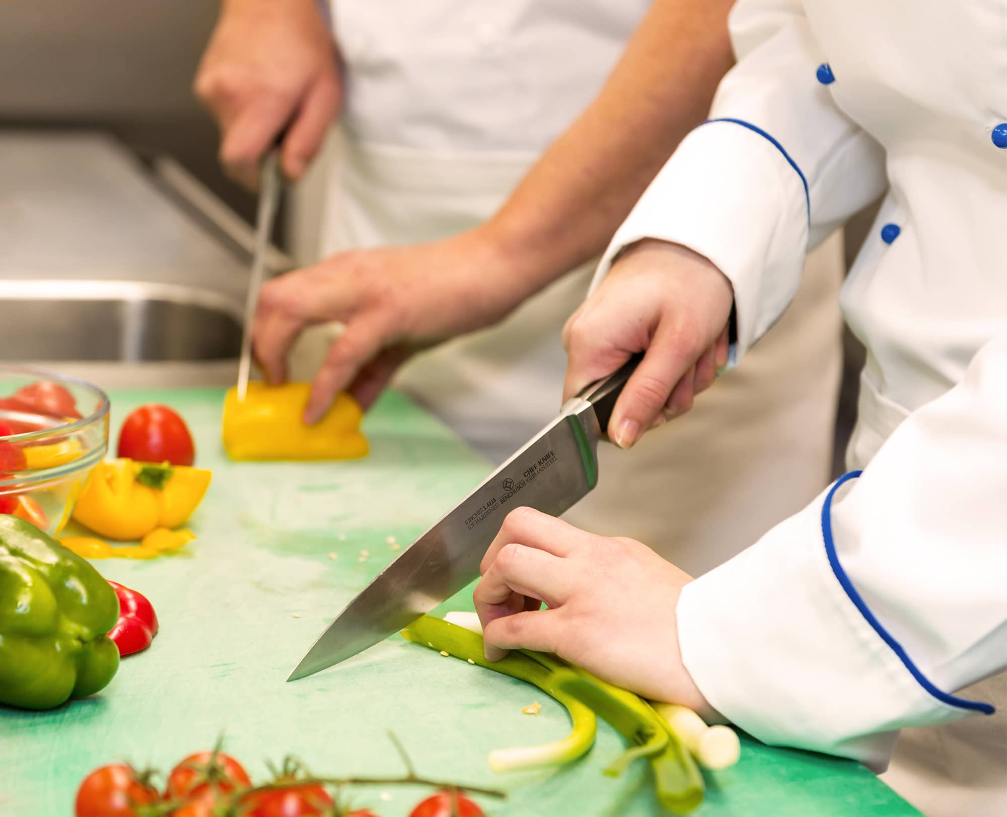 Chefs use Benchusch Professional 8-Inch Chef Knife cutting vegetables in the kitchen