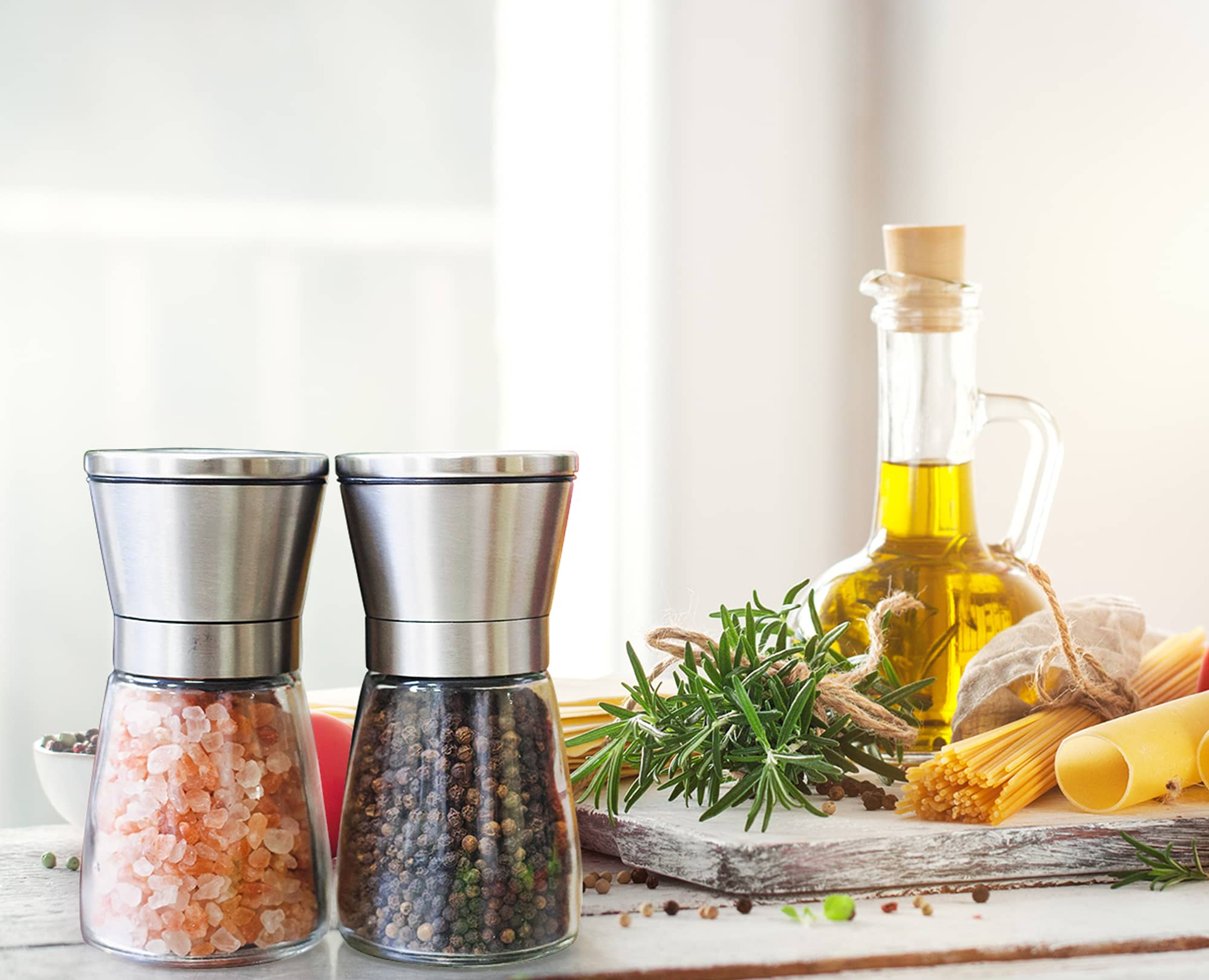 Benchusch Salt and Pepper Mills Set on the Table with many spices