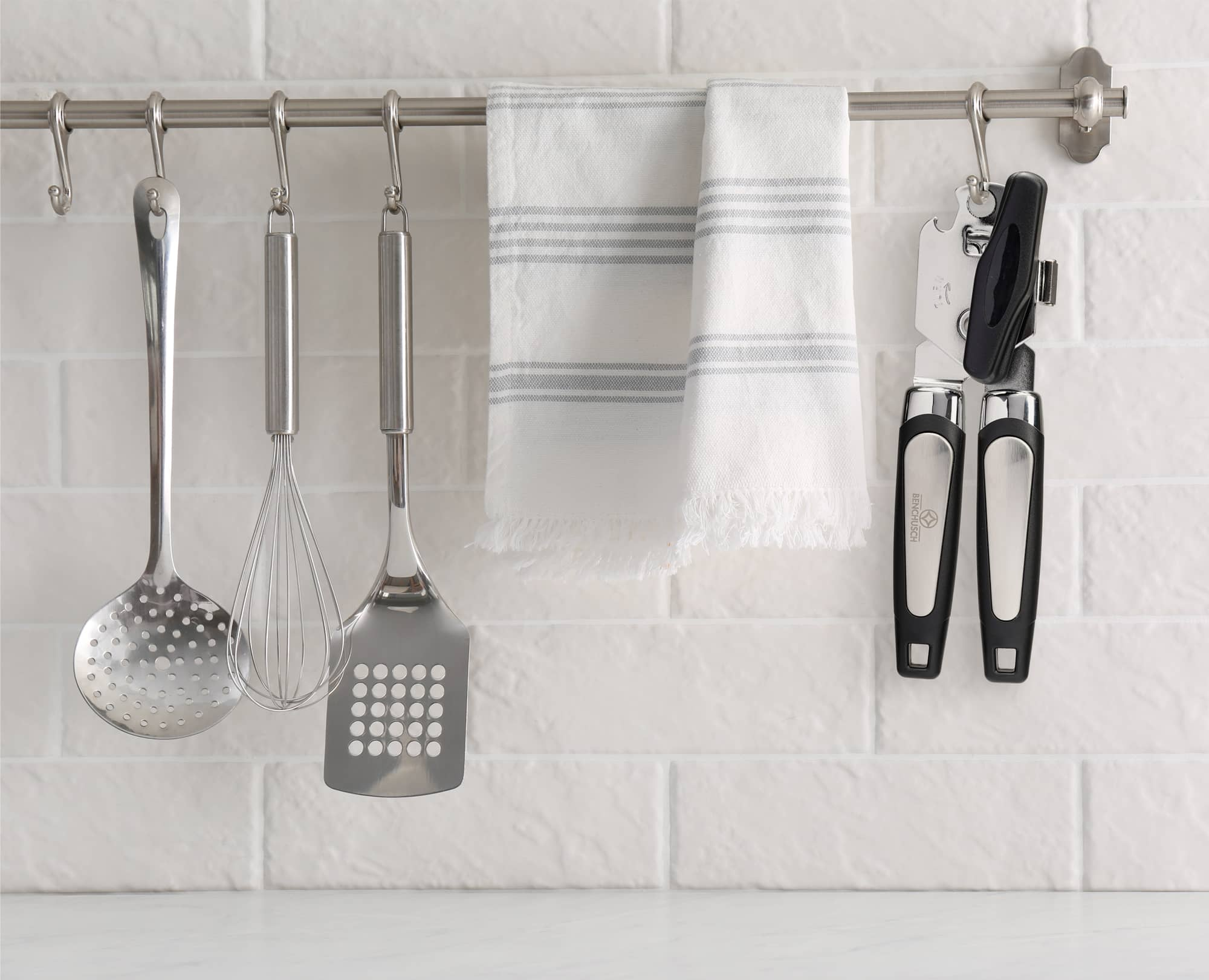 Benchusch Classia Can Opener is hung on the wall