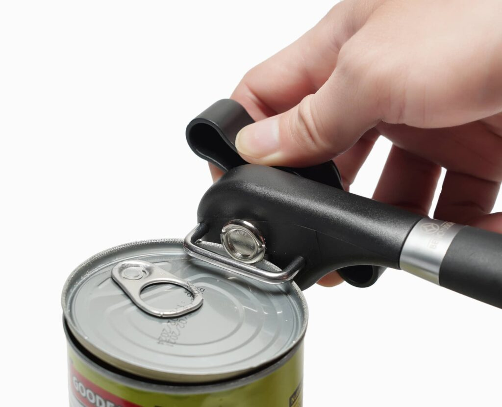 Man's opening the can with Benchusch Covera Smooth Edge Can Opener