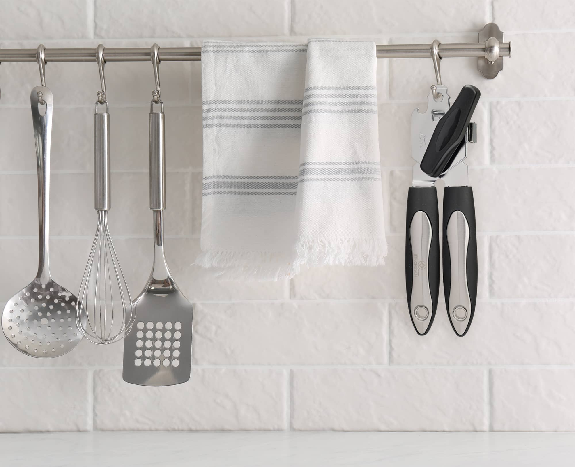 Hanging the Benchusch Magnet Classia Can Opener on the kitchen