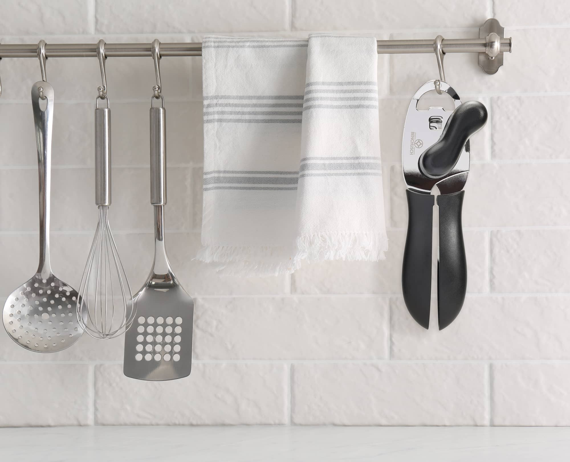 Benchusch Mordena Can Opener with Easy Turn Knob hung on the kitchen with other utensils
