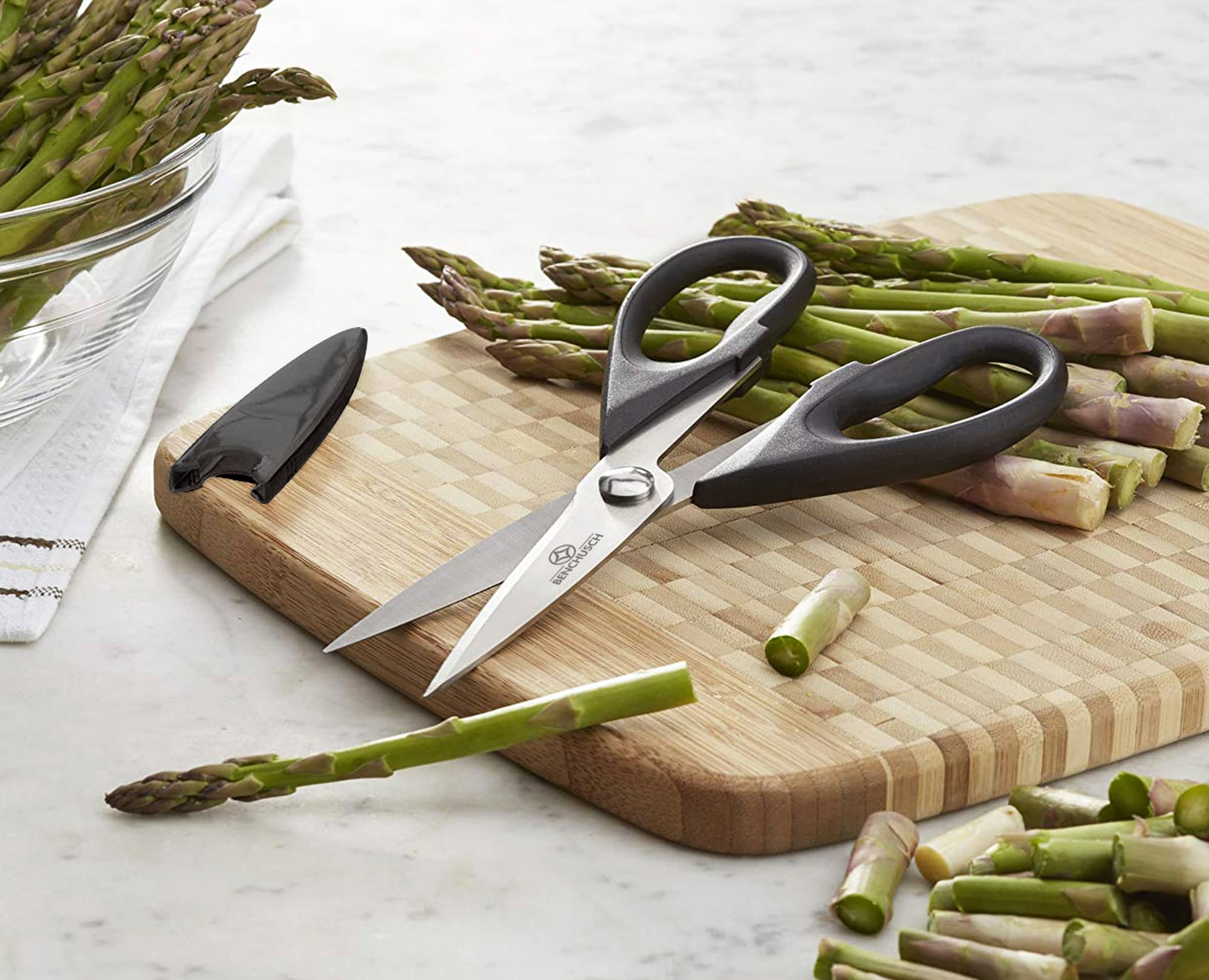 Benchusch Heavy Duty Kitchen Shears with cutting asparagus on the wooden board in the marble background