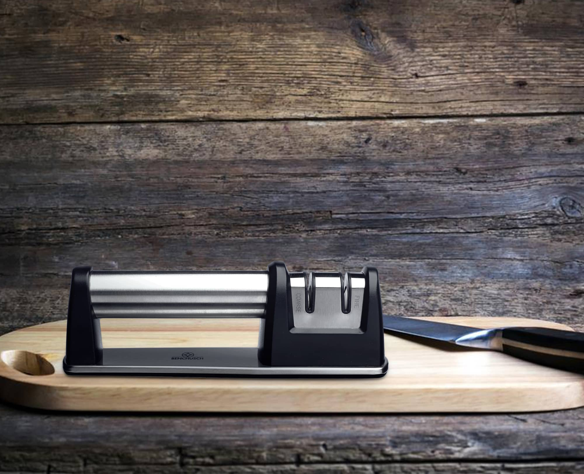 Benchusch Two-Stage Knife Sharpener on the chopping board with knife in the dark wood background